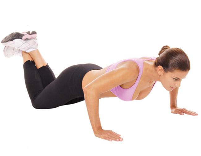Flexão de braço com apoio no joelhos